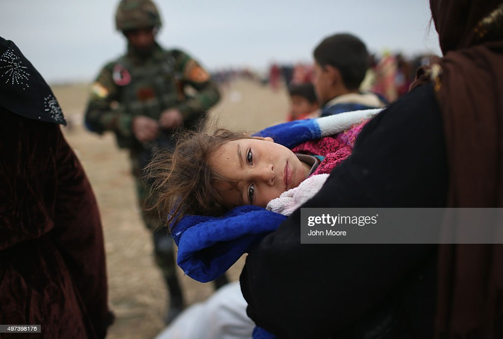 Civilians flee from their ISIL or Daesh-held frontline village to a Kurdish-controlled area on November 16, 2015 to Sinjar, Iraq. Peshmerga forces carefully screened the displaced Iraqis as they arrived, fearing enemy infiltrators and suicide bombers. Kurdish forces, with the aid of massive U.S.-led coalition airstrikes, liberated Sinjar from ISIL extremists, known in Arabic as Daesh, moving the frontline south. About a thousand villagers in Ghabosyeh fled north to Kurdish held territory, to take refuge camps or onward as refugees to Turkey or Europe.