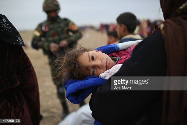 Civilians flee from their ISIL or Daeshheld frontline village to a Kurdishcontrolled area on November 16 2015 to Sinjar Iraq Peshmerga forces...