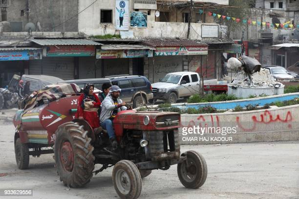 Civilians flee the city of Afrin in northern Syria on March 18 after Turkish forces and their rebel allies took control of the Kurdishmajority city...