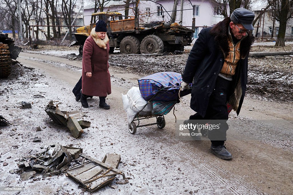 Civilians flee Uglegorsk on February 7, 2015 in Uglegorsk, Ukraine. According to Pro-Russian rebels, control of Uglegorsk, on the frontline near Debaltseve, was regained two days ago, after eight days of fierce fighting.