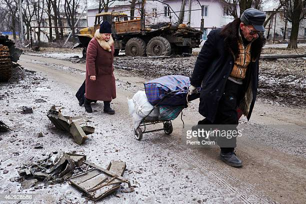 Civilians flee Uglegorsk on February 7 2015 in Uglegorsk Ukraine According to ProRussian rebels control of Uglegorsk on the frontline near Debaltseve...