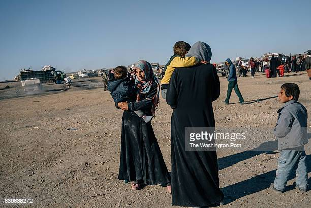 Civilians fleeing fighting between YPG/SDF and ISIS in the countryside of Raqqa are seen on the yard of a screening center in Ain Issa