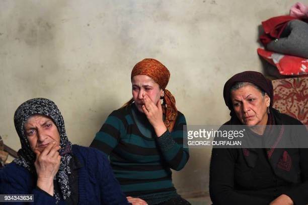 Civilians fleeing the city of Afrin in northern Syria gather inside an abandoned house in the village of azZiyarah an area that is jointly held by...