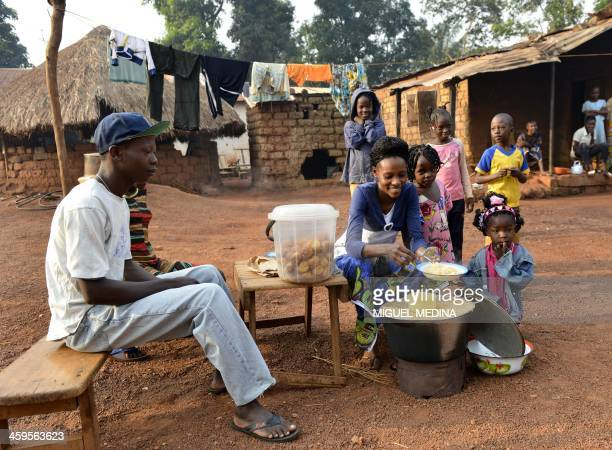 Civilians from the Fouh district in Bangui prepare breakfast on December 28 2013 The United Nations said yesterday it would speed up planning for a...