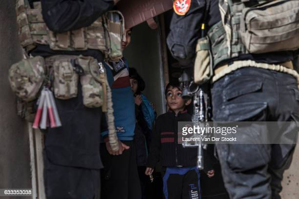 Civilians in Mosul leave their homes as members of Iraqi Special Operations Forces enter Mosul to retake the city from the Islamic State. The...