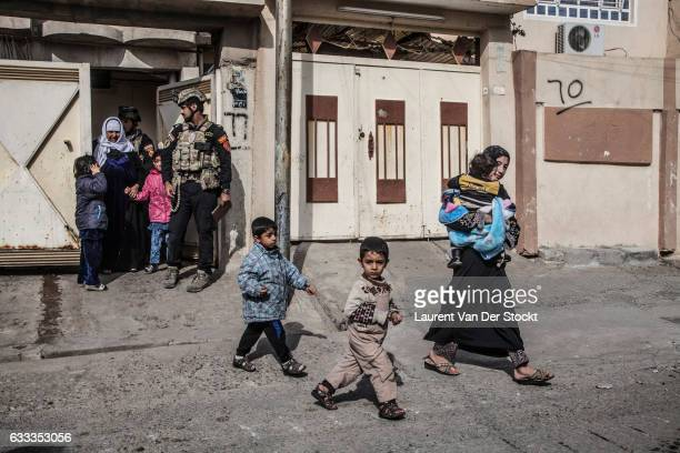 Civilians in Mosul leave their homes as members of Iraqi Special Operations Forces enter Mosul to retake the city from the Islamic State.