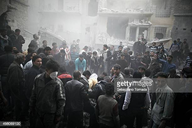 Civilians look for survivors after a airstrike leveled a series of buildings in a residential neighborhood of Aleppo Syria March 20 2013