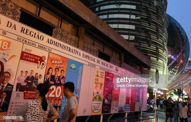 Civilians of Macau look at posters for the Legislative Assembly Election at the Rua Norte Do Mercado Almirante Lacerda in Macau. 17SEP17 SCMP /...