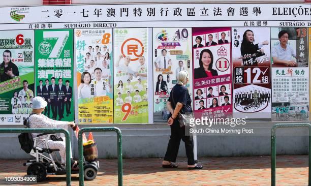 Civilians of Macau walk past posters for the Legislative Assembly Election at the Rua Norte Do Mercado Almirante Lacerda in Macau. 17SEP17 SCMP /...
