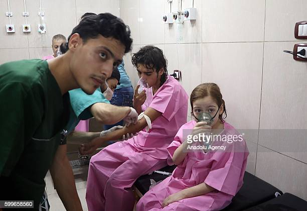 Civilians receive medical treatment at Sahara Hospital after a helicopter belonging to the Assad regime forces carried out a barrel bomb attack over...