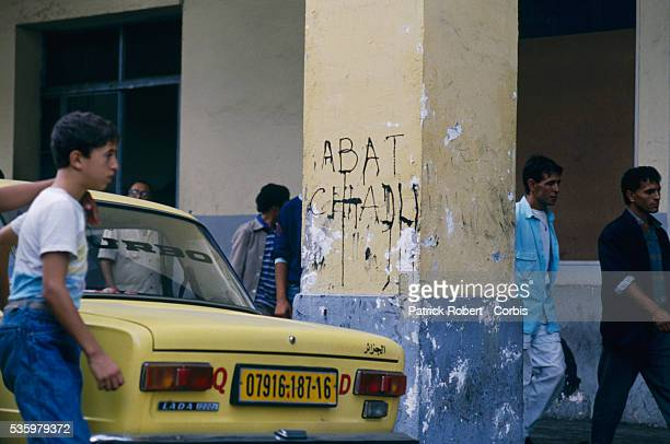 Civilians return to the graffiticovered streets of Algiers after riots broke out instigated by rising food prices in a country with an unemployment...