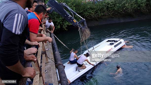 Civilians try to rescue people from a bus, carrying primary school students, teachers and parents, toppling over irrigation channel in Osmaniye,...