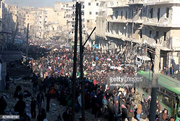Civilians trying to flee from East Aleppo that had been under siege by Iran led Shiite militias and Assad Regime forces wait to be evacuated at...