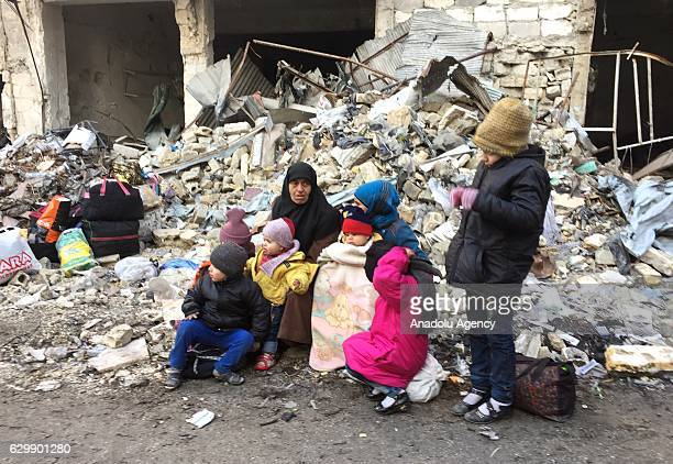 Civilians wait to be evacuated from Aleppo under the siege of Iranianled Shia militias and Assad regime forces in Aleppo Syria on December 15 2016