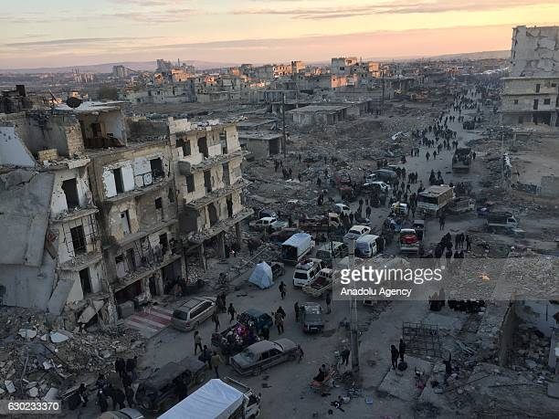 Civilians wait to be evacuated from the east part of Aleppo that had been under siege by Assad Regime forces and its supporter foreign terrorist...