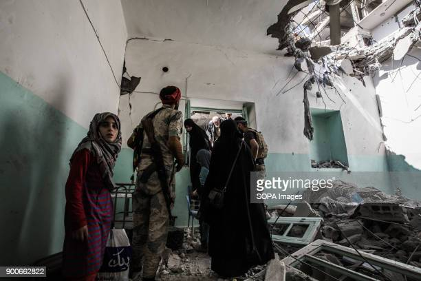 Civilians walks up through city ruins while fleeing fighting in IS controlled area More than a thousand dead and a city in ruins The Syrian civil war...