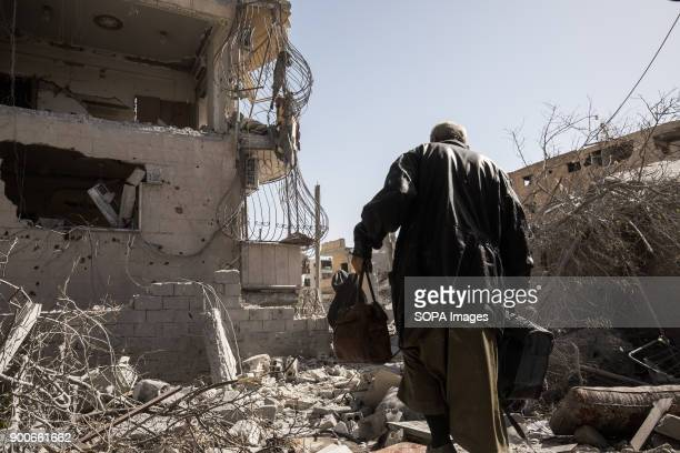 Civilians walks up through city ruins while fleeing fighting in Islamic state controlled areaMore than a thousand dead and a city in ruins The Syrian...