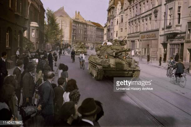 Civilians Watching US Troops as they Advance Through Dusseldorf Germany Central Europe Campaign Western Allied Invasion of Germany 1945