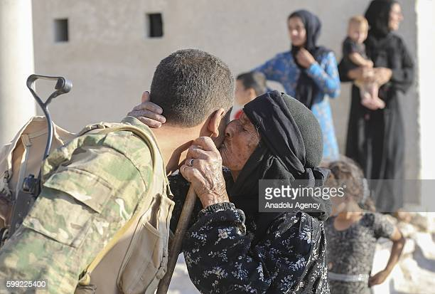 Civilians welcome the members of Free Syrian Army patrol at Kandura town after it freed from Daesh terrorists during the Operation Euphrates Shield...