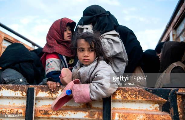 TOPSHOT Civilians who fled from the embattled Baghouz area in the eastern Syrian province of Deir Ezzor sit in a truck on February 14 2019 during an...