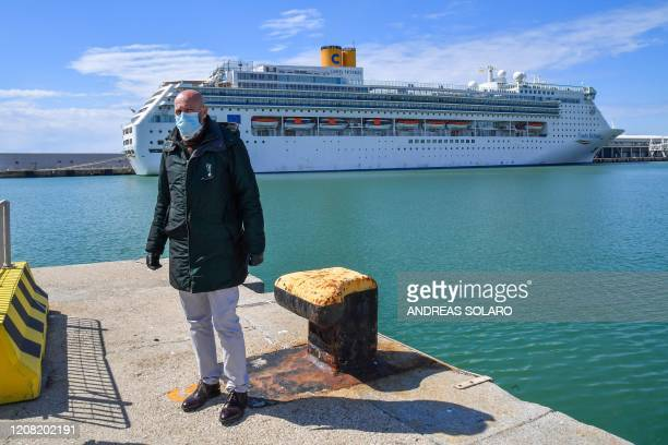 Civitavecchia mayor Ernesto tedesco is pictured by Italy's Costa Cruises ship Costa Victoria, after the ship docked at the port of Civitavecchia,...