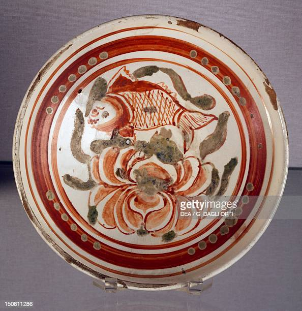 Cizhou bowl decorated with a peony and a fish porcelain with green and red enamel China Chinese Civilisation Jin Dynasty 12th13th century