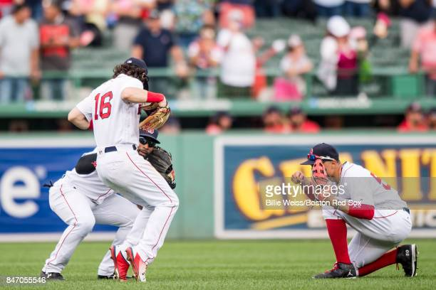CJackie Bradley Jr #19 Andrew Benintendi and Mookie Betts of the Boston Red Sox celebrate a victory against the Oakland Athletics on September 14...