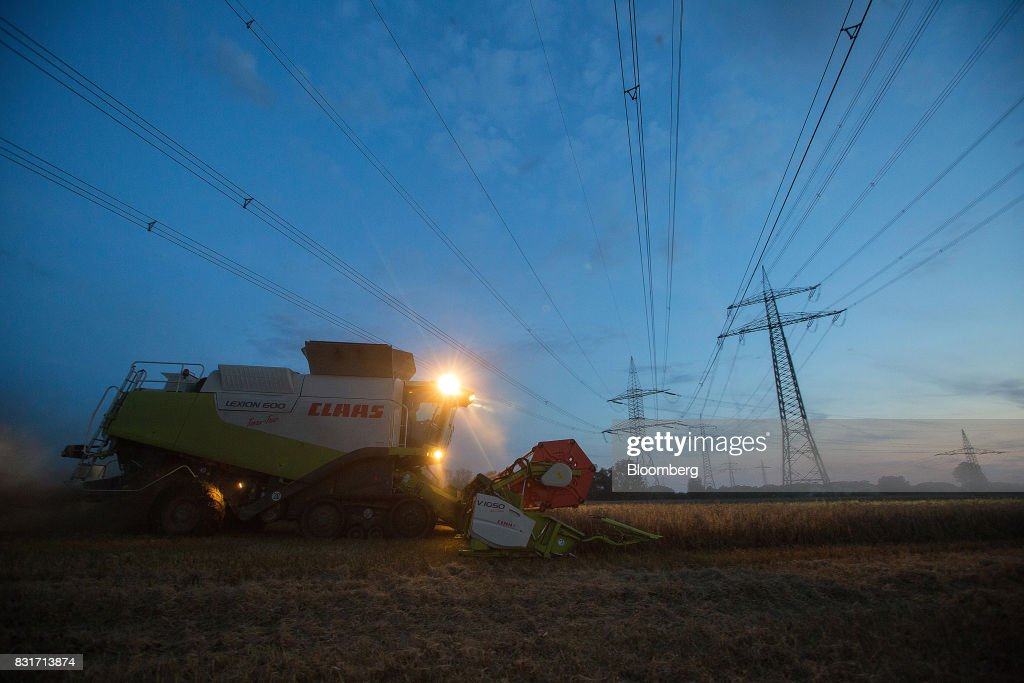 A Claas KGaA Lexion 600 combine harvester operates in a wheat field below electricity cables in Wustermark, Germany, on Monday, Aug. 14, 2017. In Germany, problems with specific weight and Hagberg, a measure of baking quality, mean as much as 40 percent of wheat may have to go to the animal feed market this year. Photographer: Krisztian Bocsi/Bloomberg via Getty Images