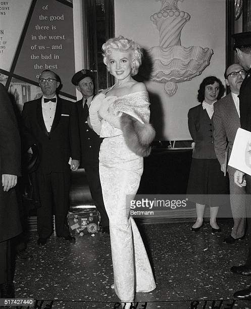 Clad in a tightlyfitted gown Marilyn Monroe arrives at the Astor Theatre tonight for the benefit premiere of East of Eden Marilyn served as an...