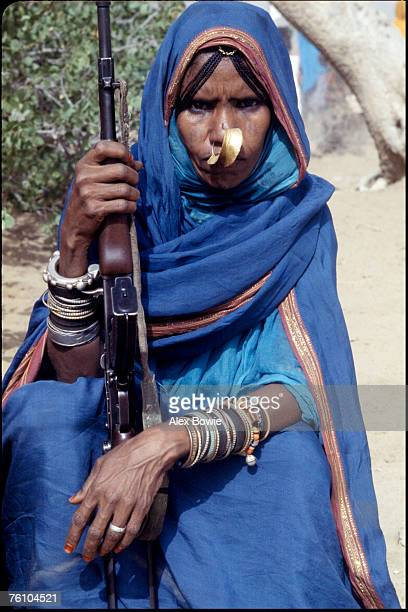 Clad in a traditional abaya and adorned with jewelry a Moslem fighter of the Eritrean People's Liberation Front holds a Russianmade Kalashnikov AK47...