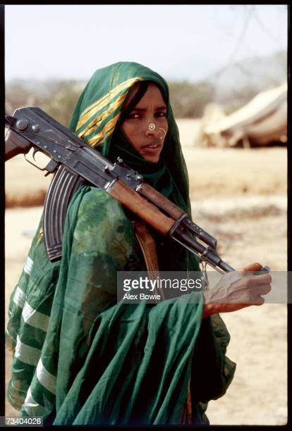Clad in a traditional abaya this Moslem fighter of the Eritrean People's Liberation Front is considered an equal among her male colleagues in the...