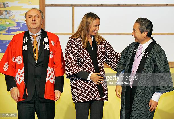 Clad in Japanese traditional happi coats beside German State Secretary for Environment Mattias Machnig Italian Environment Land and Sea Minister...