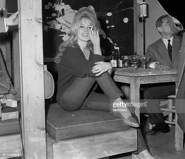 Clad in jeans and sweater, Brigitte Bardot receives newsmen on amovie set in Paris late May 31. She was working in the last scenes of her latest film...