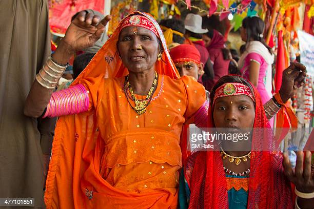 Clad in the lovely colorful dresses, a mother and the daughter are posing for a snap outside there the KALI MATA temple. HINGLAJ YATRA is the most...