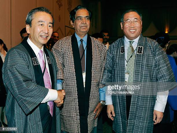 Clad in traditional Japanese half coats called happi Japanese Environment Minister Ichiro Kamoshita shares a light moment with Indian Environment and...
