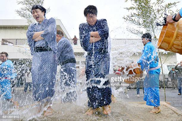Clad only in thin cotton summer kimono four recently married men are soaked with icy water by four bachelors in a rare festival dating back some 400...