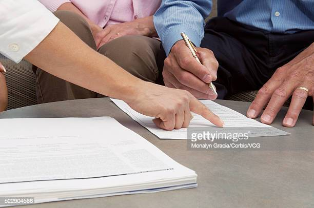 Claims adjuster pointing at document