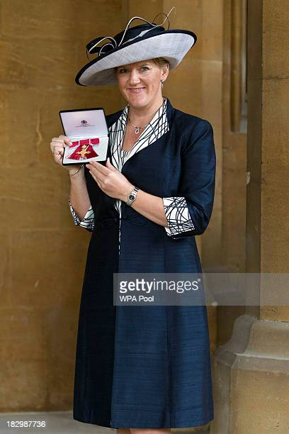 Claire Balding receives an OBE for services to Brodcasting and Journalism at Windsor Castle on October 3 2013 in Widsor England