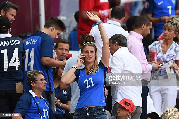 Claire Beaudouin wife of France's defender Laurent Koscielny waves prior to the start of the Euro 2016 final football match at the Stade de France in...