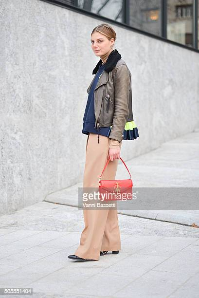 Claire Beermann poses wearing an Acne Studios jacket Nike top and JW Anderson bag before the Canali show during the Milan Men's Fashion Week...