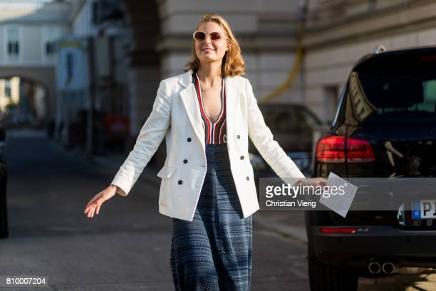 Claire Beermann wearing a white blazer navy dress during the MercedesBenz Fashion Week Berlin Spring/Summer 2018 at Kronprinzenpalais on July 6 2017...