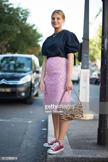 Claire Bermann poses wearing Converse shoes after the Olympia Le Tan show at the Rex Club during Paris Fashion Week Womenswear SS17 on October 3 2016...