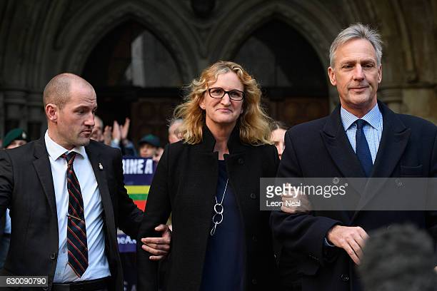 Claire Blackman, the wife of imprisoned marine Alexander Blackman, is escorted through the media following the adjournment of his bail hearing at...