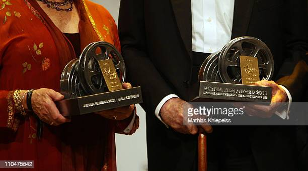 Claire Bloom and Sir Christopher Lee present their trophies at the 2nd Orange Filmball Vienna at the Townhall on March 18 2011 in Vienna Austria