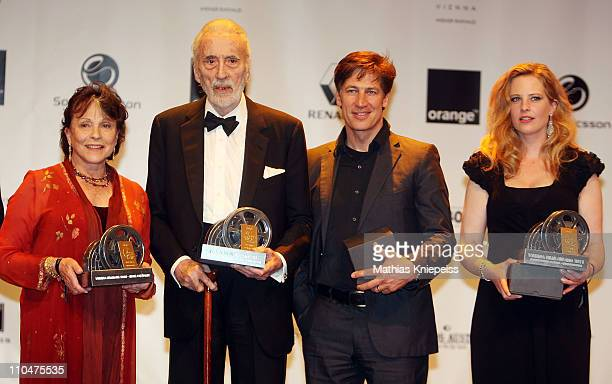 Claire Bloom Sir Christopher Lee Tobias Moretti and Diana Amft present their trophies at the 2nd Orange Filmball Vienna at the Townhall on March 18...