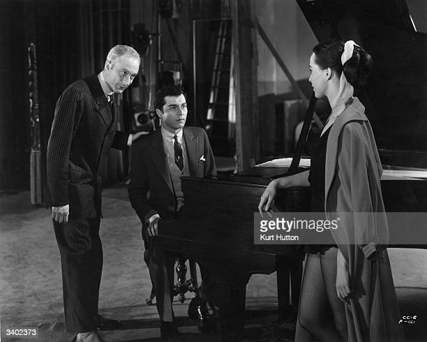 Claire Bloom Sydney Chaplin Jnr and Norman Lloyd in a scene from the United Artists film 'Limelight' which was written directed and produced by...
