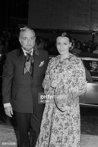 Claire Bloom wearing brocade with an escort circa 1970 New York