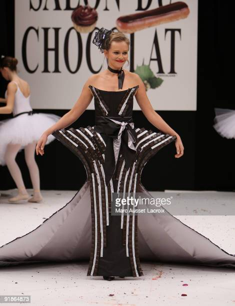 Claire Borotra displays a chocolate decorated dress during the Chocolate dress fashion show celebrating Salon Du Chocolat 15th Anniversary Opening...