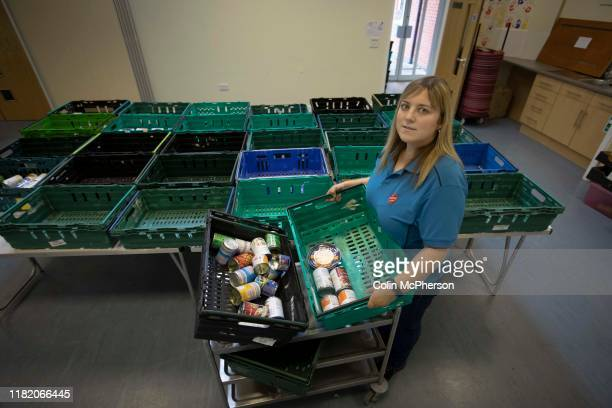 Claire Bowerman pictured sorting donations at the Salvation Army in Preston Lancashire which runs a food bank and where supplies of food for...
