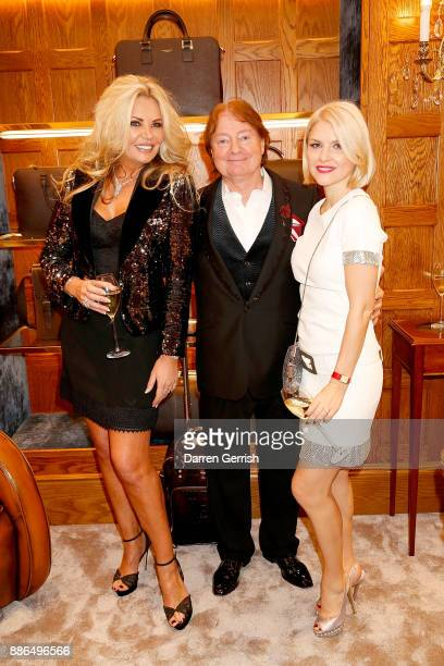 Claire Caudwell Iain Burton and Mariya Dykalo attend the new flagship store launch of Aspinal on Regent's Street St James's on December 5 2017 in...